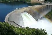 kariba dam wall with floodgates open